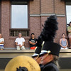 Record-Eagle/Keith King<br /> Spectators watch the Touchstone Energy Junior Royale Parade Thursday, July 7, 2011 from the second story of a building along Union Street.