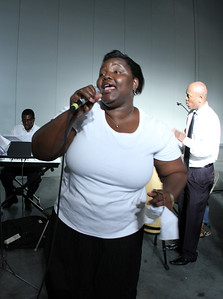 "Felicite Koffi, a native of the West Africa's Ivory Coast and member of St. Patrick Church, Norcross, sings a song entitled ""Jesus Is Good"" in the Francophone Track."