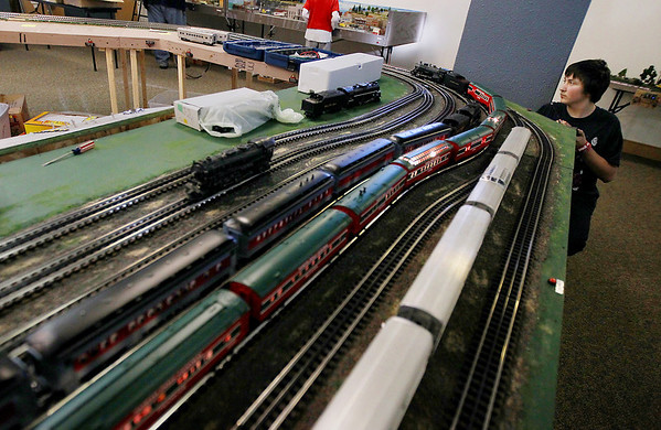 Record-Eagle/Keith King<br /> Toby Pasman, 17, of Interlochen, operates a train using a remote control as preparations are made Saturday, December 10, 2011 by members of the Northern Michigan Railroad Club at the History Center of Traverse City for the Festival of Trains which begins Wednesday, December 14, 2011.