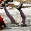 "A Polar Plunge participant goes head-first into the frozen body of water on Saturday, March 5, during ""Frozen Dead Guy Days"" in Nederland. For more photos and video go to  <a href=""http://www.dailycamera.com"">http://www.dailycamera.com</a><br /> Jeremy Papasso/ Camera"