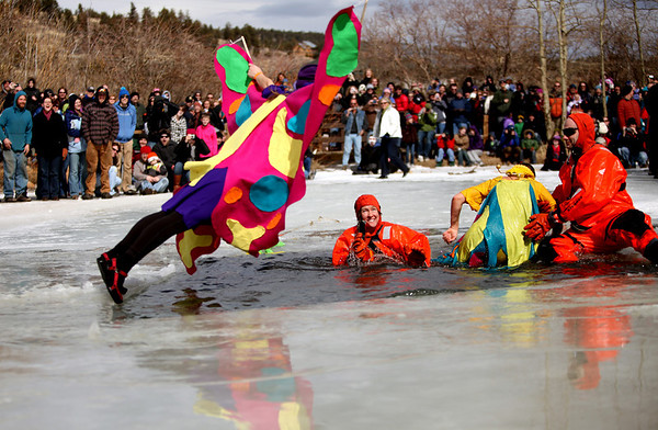 PolarPlunge004.jpg Jennifer Duke soars into an icy pond during the Polar Plunge on Saturday March, 5, during 10th annual Frozen Dead Guy Days in Nederland. <br /> Chancey Bush / The Camera