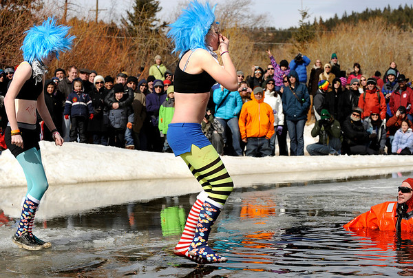 """Participants jump into the icy water on Saturday, March 5, during """"Frozen Dead Guy Days"""" in Nederland. For more photos and video go to  <a href=""""http://www.dailycamera.com"""">http://www.dailycamera.com</a><br /> Jeremy Papasso/ Camera"""