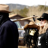 "Janet Johnson, of Loveland, right, stands behind the sling blade of Ricardo Dreith, of Loveland, before the start of the coffin parade on Saturday, March 5, during ""Frozen Dead Guy Days"" in Nederland. For more photos and video go to  <a href=""http://www.dailycamera.com"">http://www.dailycamera.com</a><br /> Jeremy Papasso/ Camera"