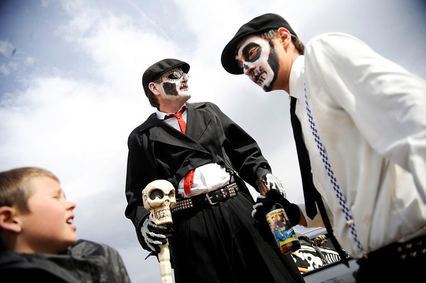 """Davis Edge, of Arvada, center, and Kyle Sinanaj, of Santa Fe, N.M., right, share a conversation with a boy, not named, on Saturday, March 5, during """"Frozen Dead Guy Days"""" in Nederland. For more photos and video go to  <a href=""""http://www.dailycamera.com"""">http://www.dailycamera.com</a><br /> Jeremy Papasso/ Camera"""