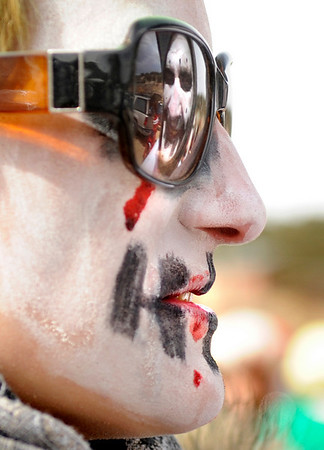 "The reflection of Adam Golden, of Sante Fe, N.M., is seen in the sunglasses of Tesa Sinanaj, also of Sante Fe, during the start of the coffin parade on Saturday, March 5, during ""Frozen Dead Guy Days"" in Nederland. For more photos and video go to  <a href=""http://www.dailycamera.com"">http://www.dailycamera.com</a><br /> Jeremy Papasso/ Camera"