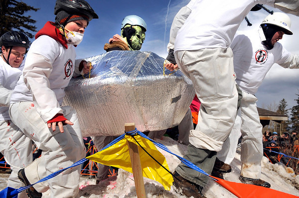 """Team """"Nederterrestrial Area 51"""" hustles over an obstacle while competing in the coffin races on Saturday, March 5, during """"Frozen Dead Guy Days"""" in Nederland. For more photos and video go to  <a href=""""http://www.dailycamera.com"""">http://www.dailycamera.com</a><br /> Jeremy Papasso/ Camera"""