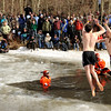 "Participants of the Polar Plunge slap each other high-five before plunging into the icy water on Saturday, March 5, during ""Frozen Dead Guy Days"" in Nederland. For more photos and video go to  <a href=""http://www.dailycamera.com"">http://www.dailycamera.com</a><br /> Jeremy Papasso/ Camera"