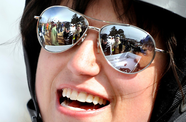 "Megan Koegel, of Boulder, laughs with her team as they carry their coffin to the starting line for the coffin races on Saturday, March 5, during ""Frozen Dead Guy Days"" in Nederland. For more photos and video go to  <a href=""http://www.dailycamera.com"">http://www.dailycamera.com</a><br /> Jeremy Papasso/ Camera"
