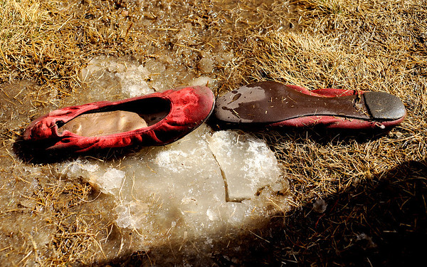 "A pair of slip on shoes sits on a chunk of ice near the frigid water where the Polar Plunge was taking place on Saturday, March 5, during ""Frozen Dead Guy Days"" in Nederland. For more photos and video go to  <a href=""http://www.dailycamera.com"">http://www.dailycamera.com</a><br /> Jeremy Papasso/ Camera"