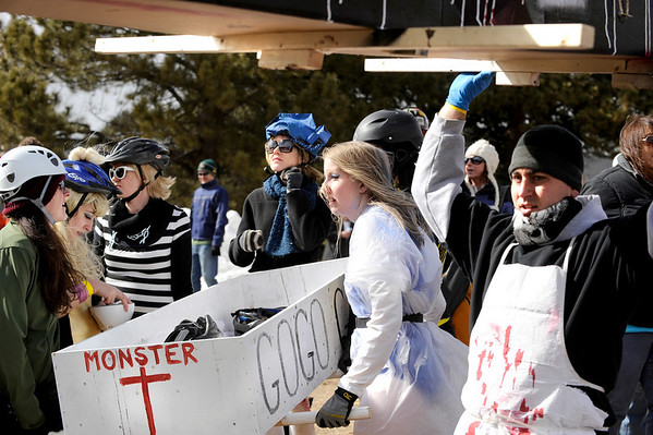 """Rob Black, of Arvada, right, helps carry his team's coffin on Saturday, March 5, during """"Frozen Dead Guy Days"""" in Nederland. For more photos and video go to  <a href=""""http://www.dailycamera.com"""">http://www.dailycamera.com</a><br /> Jeremy Papasso/ Camera"""