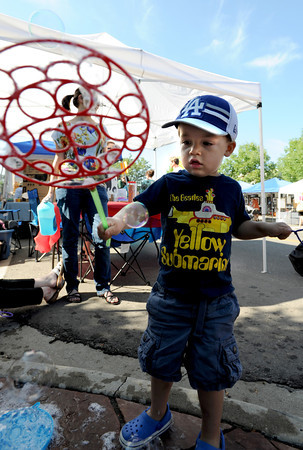 "Elijah Kapich, 2, makes bubbles during the 2011 Lafayette Peach Festival on Saturday.<br /> For more photos and a  video from the festival, go to  <a href=""http://www.dailycamera.com"">http://www.dailycamera.com</a><br /> Cliff Grassmick / August 20, 2011"