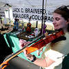 "Catherine Millis plays violin at Jack Brainerd's booth at the 2011 Lafayette Peach Festival on Saturday.<br /> For more photos and a  video from the festival, go to  <a href=""http://www.dailycamera.com"">http://www.dailycamera.com</a><br /> Cliff Grassmick / August 20, 2011"