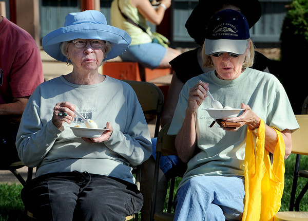 """Ethel  Berry, and her daughter, Anne Berry, try peach cobbler at  the 2011 Lafayette Peach Festival on Saturday.<br /> For more photos and a  video from the festival, go to  <a href=""""http://www.dailycamera.com"""">http://www.dailycamera.com</a><br /> Cliff Grassmick / August 20, 2011"""