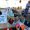 "Jim Jenso, right, makes and sells bird houses made from recycled materials during the 2011 Lafayette Peach Festival on Saturday.<br /> For more photos and a  video from the festival, go to  <a href=""http://www.dailycamera.com"">http://www.dailycamera.com</a><br /> Cliff Grassmick / August 20, 2011"