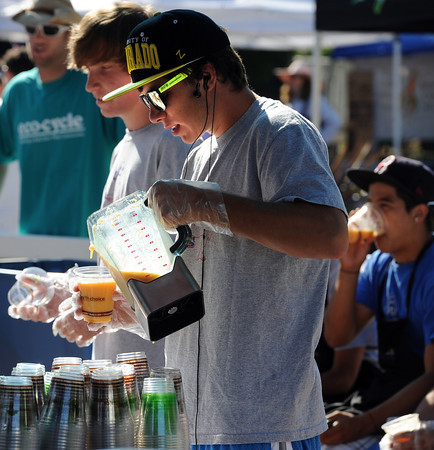 """Ryan Ebersole, of the Centaurus soccer team, makes peach smoothies with his teammates as they volunteer for the 2011 Lafayette Peach Festival.<br /> For more photos and a  video from the festival, go to  <a href=""""http://www.dailycamera.com"""">http://www.dailycamera.com</a><br /> Cliff Grassmick / August 20, 2011"""