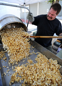 Tony George makes kettle corn during the 2011 Lafayette Peach Festival on Saturday. For more photos and a  video from the festival, go to www.dailycamera.com Cliff Grassmick / August 20, 2011