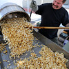 "Tony George makes kettle corn during the 2011 Lafayette Peach Festival on Saturday.<br /> For more photos and a  video from the festival, go to  <a href=""http://www.dailycamera.com"">http://www.dailycamera.com</a><br /> Cliff Grassmick / August 20, 2011"