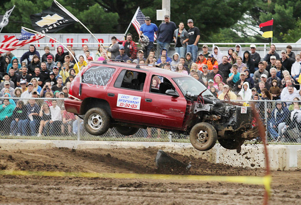Record-Eagle/Keith King<br /> Ray Philo, of Interlochen, gets air Saturday, August 13, 2011 as he competes in the stock division of the Tough Truck Competition at the Northwestern Michigan Fair.