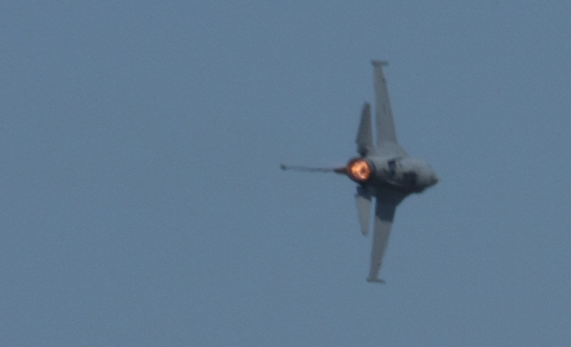 "An F-16 performing a ""high-G"" turn in front of show central at the 2011 Oregon Airshow. (Sunday)"