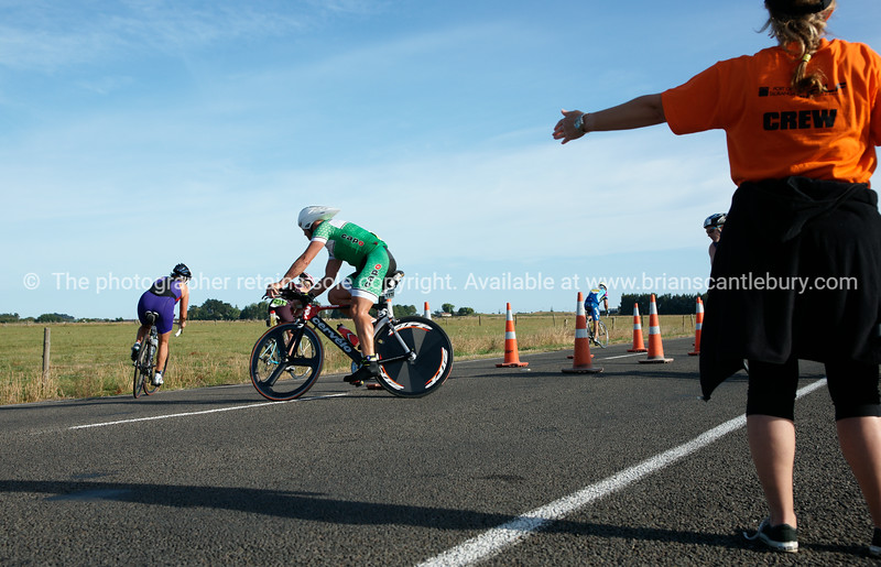 "Tauranga POT Half Ironman, 2010  at Bell Road turnaround, with marshal directing,  Tauranga, New Zealand. Contestant 1178 in 2010 Tauranga is New Zealands 5th largest city and offers a wonderfull variety of scenic and cultural experiences. ALSO SEE; <a href=""http://www.blurb.com/b/3811392-tauranga"">http://www.blurb.com/b/3811392-tauranga</a>"