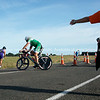 """Tauranga POT Half Ironman, 2010  at Bell Road turnaround, with marshal directing,  Tauranga, New Zealand. Contestant 1178 in 2010 Tauranga is New Zealands 5th largest city and offers a wonderfull variety of scenic and cultural experiences. ALSO SEE; <a href=""""http://www.blurb.com/b/3811392-tauranga"""">http://www.blurb.com/b/3811392-tauranga</a>"""