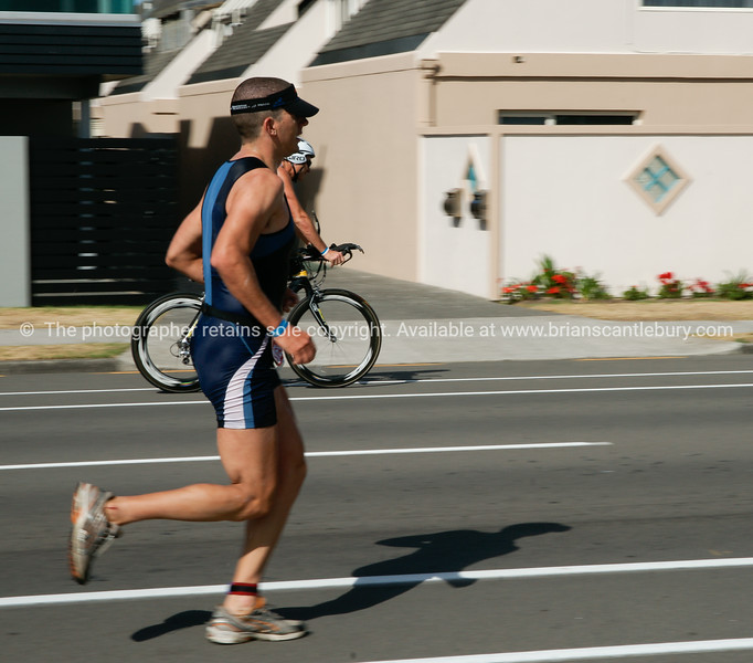 "Port of Tauranga Half Ironman triathalon contestant running. Tauranga is New Zealands 5th largest city and offers a wonderfull variety of scenic and cultural experiences. ALSO SEE; <a href=""http://www.blurb.com/b/3811392-tauranga"">http://www.blurb.com/b/3811392-tauranga</a>"