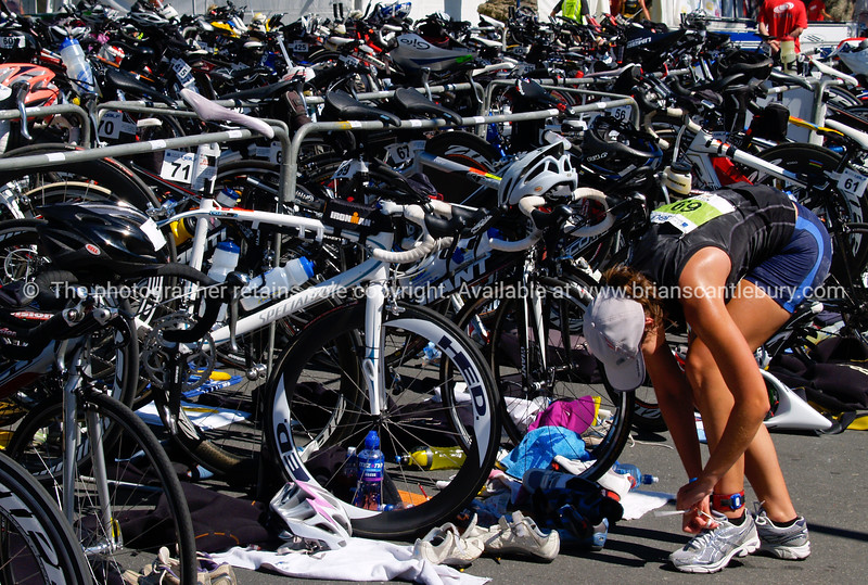 "Port of Tauranga Half Ironman, 2011, contestant chages running shoes in the cycle transition area. 69, Kelly Mabbett. Tauranga is New Zealands 5th largest city and offers a wonderfull variety of scenic and cultural experiences. ALSO SEE; <a href=""http://www.blurb.com/b/3811392-tauranga"">http://www.blurb.com/b/3811392-tauranga</a>"