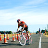 """Port of Tauranga Half Ironman, Contestant in at Bell Road turnaround,  Tauranga, New Zealand. POT Half Ironman-5 Tauranga is New Zealands 5th largest city and offers a wonderfull variety of scenic and cultural experiences. ALSO SEE; <a href=""""http://www.blurb.com/b/3811392-tauranga"""">http://www.blurb.com/b/3811392-tauranga</a>"""