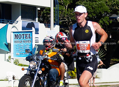 Port of Tauranga Half Ironman, 2011, New Zealand. Jeremy Boyd, contestant 23, running on Marine Parade. Tauranga is New Zealands 5th largest city and offers a wonderfull variety of scenic and cultural experiences. ALSO SEE; http://www.blurb.com/b/3811392-tauranga