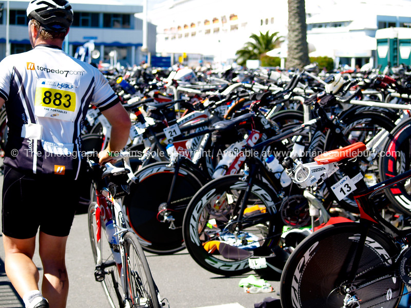 "Port of Tauranga Half Ironman, 2011, contestant 883 comes into the transition area.Member of ""The Portables""team. Tauranga is New Zealands 5th largest city and offers a wonderfull variety of scenic and cultural experiences. ALSO SEE; <a href=""http://www.blurb.com/b/3811392-tauranga"">http://www.blurb.com/b/3811392-tauranga</a>"