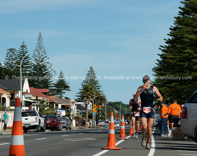 """David & Jared Bowden running on Marine Parade in the 2010 Port of tauranga Half Ironman. Tauranga New Zealand. Tauranga is New Zealands 5th largest city and offers a wonderfull variety of scenic and cultural experiences. ALSO SEE; <a href=""""http://www.blurb.com/b/3811392-tauranga"""">http://www.blurb.com/b/3811392-tauranga</a>"""