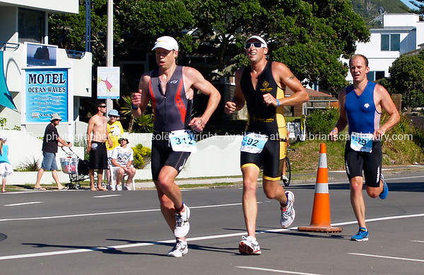 "Port of Tauranga Half Ironman, 2011, runners on Marine Parade, Bron Healey, Sam Daley, & Shanon Barnett. Tauranga is New Zealands 5th largest city and offers a wonderfull variety of scenic and cultural experiences. ALSO SEE; <a href=""http://www.blurb.com/b/3811392-tauranga"">http://www.blurb.com/b/3811392-tauranga</a>"