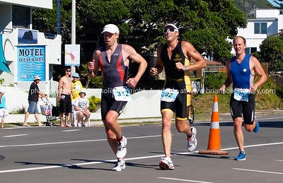 Port of Tauranga Half Ironman, 2011, runners on Marine Parade, Bron Healey, Sam Daley, & Shanon Barnett. Tauranga is New Zealands 5th largest city and offers a wonderfull variety of scenic and cultural experiences. ALSO SEE; http://www.blurb.com/b/3811392-tauranga