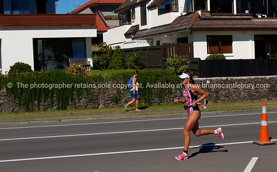 Port of Tauranga Half Ironman, 2011, Julia Grant strides out along Marine Parade. Tauranga is New Zealands 5th largest city and offers a wonderfull variety of scenic and cultural experiences. ALSO SEE; http://www.blurb.com/b/3811392-tauranga