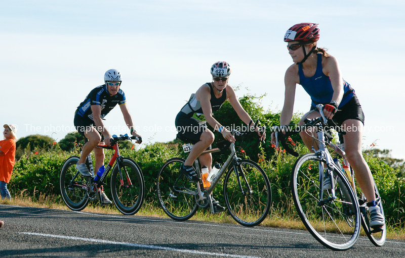 "Contestants (3) including 1056 & 423 in 2010 POT Half Ironman - Bell road cycle turnaround, Tauranga, New Zealand. Tauranga is New Zealands 5th largest city and offers a wonderfull variety of scenic and cultural experiences. ALSO SEE; <a href=""http://www.blurb.com/b/3811392-tauranga"">http://www.blurb.com/b/3811392-tauranga</a>"