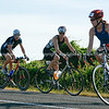 """Contestants (3) including 1056 & 423 in 2010 POT Half Ironman - Bell road cycle turnaround, Tauranga, New Zealand. Tauranga is New Zealands 5th largest city and offers a wonderfull variety of scenic and cultural experiences. ALSO SEE; <a href=""""http://www.blurb.com/b/3811392-tauranga"""">http://www.blurb.com/b/3811392-tauranga</a>"""