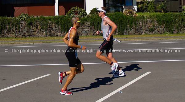 "Port of Tauranga Half Ironman, 2011, runners crossing on marine Parade. Tauranga is New Zealands 5th largest city and offers a wonderfull variety of scenic and cultural experiences. ALSO SEE; <a href=""http://www.blurb.com/b/3811392-tauranga"">http://www.blurb.com/b/3811392-tauranga</a>"
