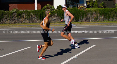 Port of Tauranga Half Ironman, 2011, runners crossing on marine Parade. Tauranga is New Zealands 5th largest city and offers a wonderfull variety of scenic and cultural experiences. ALSO SEE; http://www.blurb.com/b/3811392-tauranga