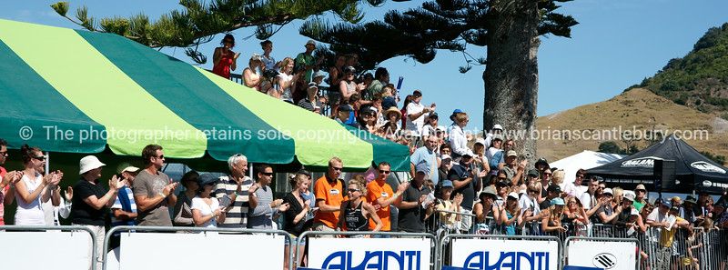 """Spectators at 2010 POT Half Ironman finish line, clapping and cheering. Tauranga is New Zealands 5th largest city and offers a wonderfull variety of scenic and cultural experiences. ALSO SEE; <a href=""""http://www.blurb.com/b/3811392-tauranga"""">http://www.blurb.com/b/3811392-tauranga</a>"""