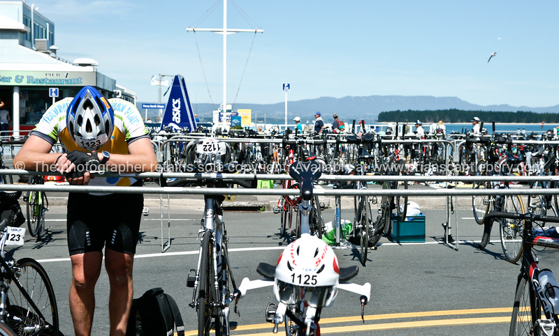 """Tired athelete at bike station, Port of tauranga Half Ironman. 2010. Tauranga is New Zealands 5th largest city and offers a wonderfull variety of scenic and cultural experiences. ALSO SEE; <a href=""""http://www.blurb.com/b/3811392-tauranga"""">http://www.blurb.com/b/3811392-tauranga</a>"""