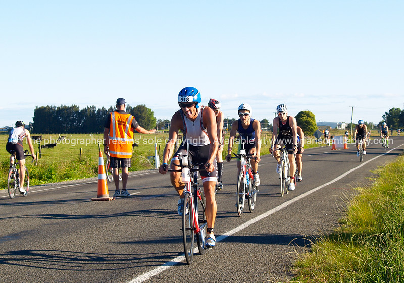 "Port of Tauranga Half Ironman, 2011, New Zealand. Contestant 518, Craig Wigglesworth leads a small group at the cycle Parton Road turnaround. Tauranga is New Zealands 5th largest city and offers a wonderfull variety of scenic and cultural experiences. ALSO SEE; <a href=""http://www.blurb.com/b/3811392-tauranga"">http://www.blurb.com/b/3811392-tauranga</a>"