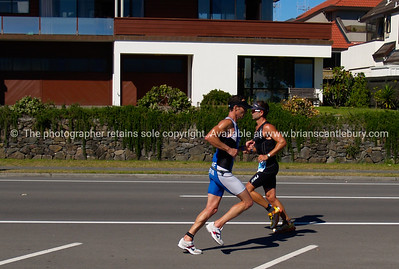 Port of Tauranga Half Ironman, 2011, two runners pass in opposing directions. Tauranga is New Zealands 5th largest city and offers a wonderfull variety of scenic and cultural experiences. ALSO SEE; http://www.blurb.com/b/3811392-tauranga