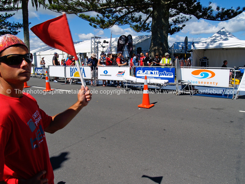 "POT Half Ironman 2011, marshall, flagging cyclists approaching transition at end of cycle leg. Tauranga is New Zealands 5th largest city and offers a wonderfull variety of scenic and cultural experiences. ALSO SEE; <a href=""http://www.blurb.com/b/3811392-tauranga"">http://www.blurb.com/b/3811392-tauranga</a>"