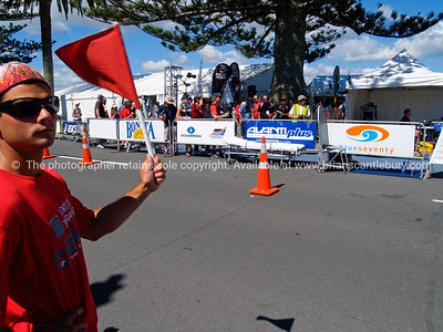 POT Half Ironman 2011, marshall, flagging cyclists approaching transition at end of cycle leg. Tauranga is New Zealands 5th largest city and offers a wonderfull variety of scenic and cultural experiences. ALSO SEE; http://www.blurb.com/b/3811392-tauranga