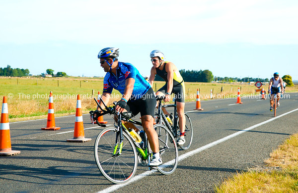 "Contestant 1054 in 2010 POT Half Ironman-4, at Bell Road turnaround,  Tauranga, New Zealand.POT Half Ironman-4 Tauranga is New Zealands 5th largest city and offers a wonderfull variety of scenic and cultural experiences. ALSO SEE; <a href=""http://www.blurb.com/b/3811392-tauranga"">http://www.blurb.com/b/3811392-tauranga</a>"