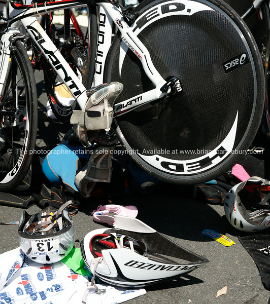 """Bicycle and helmets at Bike station, POT Half Ironman. Helmet 13. Tauranga is New Zealands 5th largest city and offers a wonderfull variety of scenic and cultural experiences. ALSO SEE; <a href=""""http://www.blurb.com/b/3811392-tauranga"""">http://www.blurb.com/b/3811392-tauranga</a>"""