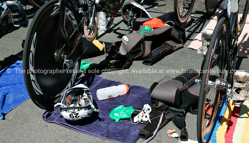"""Bike station close-up,biycles and accessories, helmet 29, 2010 Port of Tauranga Half Ironman-8 Tauranga is New Zealands 5th largest city and offers a wonderfull variety of scenic and cultural experiences. ALSO SEE; <a href=""""http://www.blurb.com/b/3811392-tauranga"""">http://www.blurb.com/b/3811392-tauranga</a>"""