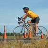 """Contestant at Bell Road cycling turn-around, POT Half Ironman-10. Tauranga, Bay of Plenty, New Zealand. Tauranga is New Zealands 5th largest city and offers a wonderfull variety of scenic and cultural experiences. ALSO SEE; <a href=""""http://www.blurb.com/b/3811392-tauranga"""">http://www.blurb.com/b/3811392-tauranga</a>"""