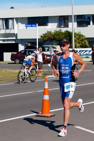 "Port of Tauranga Half Ironman, 2011, Gary Brown runs along Marine Parade. Tauranga is New Zealands 5th largest city and offers a wonderfull variety of scenic and cultural experiences. ALSO SEE; <a href=""http://www.blurb.com/b/3811392-tauranga"">http://www.blurb.com/b/3811392-tauranga</a>"
