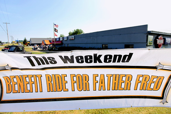 Record-Eagle/Keith King<br /> A banner is displayed outside of Classic Motor Sports Sunday, July 17, 2011 prior to the start of the annual Ride for Father Fred.